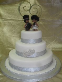 Maori themed wedding cake- celebrate your culture at your wedding. Beautiful cake decorated with a Maori Bride  Groom cake topper and special Tiki  www.frescofoods.co.nz Email: fresco@woosh.co.nz