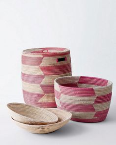 A balance of form, function, and conscience, these sculptural fair-trade baskets are handmade by the Wolof weavers of Senegal in partnership with the Peace Corps. Made from natural cattails and strips of reclaimed plastic prayer mats, they are woven in a striking pattern with just the right pop of color. The large Hamper size comes with a lid and cutout handles, making it an ideal choice for linens, firewood, toys, shoes, and larger items. The open smaller Basket is great for accessories, knitting supplies, magazines, kitchen storage, and more. The set of two Bowls (one large, one small) adds a great tabletop touch to an organized space as a place to throw mail, keys, or a remote. Beyond storage solutions, the pieces in this collection are also beautiful decorative accents.