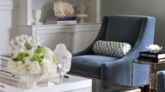 blue velvet chair + Greek key bolster in a neutral palette