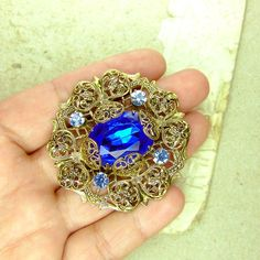 Hey, I found this really awesome Etsy listing at https://www.etsy.com/listing/152554289/filigree-brass-violet-czech-brooch