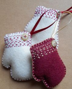 These mitten-shaped Christmas decorations are handmade to order. Available in sets of either white or red, each of the three wool felt ornaments