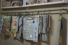 Genius! I would hang quilt patterns, stencils,  and fabric bits on here!!! Could hang on pant hangers