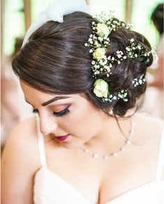 Side bun bridal hair with roses and gypsophilia