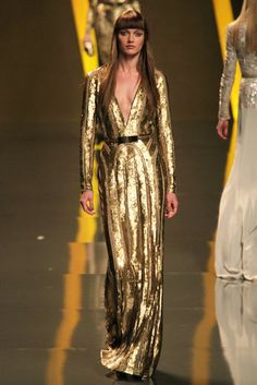 Plunging gold sequined evening gown plays up a tan from Elie Saab Autumn 2012