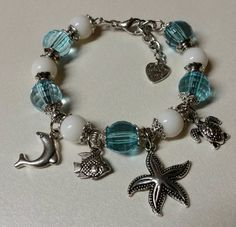Check out this item in my Etsy shop https://www.etsy.com/listing/230194838/oceanfront-charm-bangle-beach