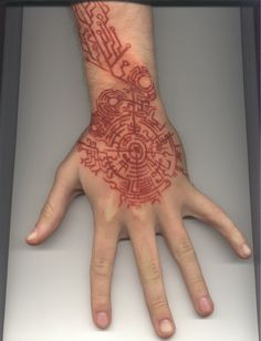 futuristic, cyberpunk  tattoo. Also a henna to put on the inside of her hand
