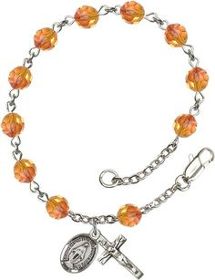 Sterling Silver Rosary Bracelet features 6mm Fire Opal Swarovski beads. The Crucifix measures 5/8 x 1/4. Each Rosary Bracelet is presented in a deluxe velvet gi