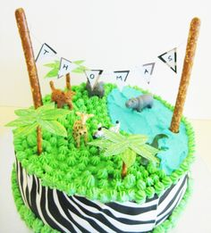 A super safari themed cake. - With ABC's around the sides instead of Zebra Stripes to match the invites. Add cupcakes?? HMMMMMmmmm???