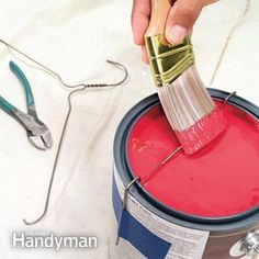 Want to paint like a pro? Try this trick with a wire hanger next time you have a painting project. Taping the bottom of a wire hanger to the paint can creates the perfect means for removing excess paint from the brush. No more drips!