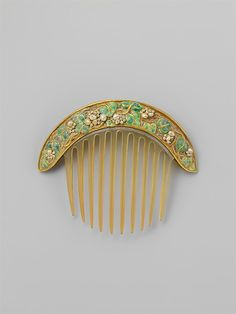 Comb made by Florence Koehler, c.1905 with gold, plearls, enamel and probably horn.