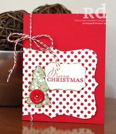 A lovely Christmas card. Love the use of bakers twine and the idea of having the Top Note die cut off the page.