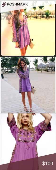 Free People dress sold out in stores Gorgeous purple embroidered Free People dress with pockets is the best dress ever! Size small. Favorite of fashion bloggers and SOLD out everywhere. Free People Dresses
