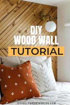 Learn how to build a modern wood accent wall like a pro with this step by step tutorial for a wood accent wall in the bedroom! Add this DIY wood wall to your projects list this year for a modern accent wall. #joyfullygrowingblog #woodwall #DIYaccentwall #woodaccentwall