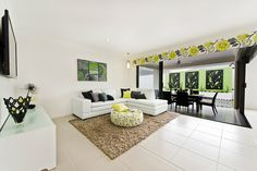 #Living #room #ideas from Ausbuild's Segal display #home.This room is bright and airy with crisp white furniture and statement pillows. www.ausbuild.com.au