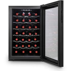 Shop Magic Chef Wine Cooler Black at Best Buy. Find low everyday prices and buy online for delivery or in-store pick-up. Thermoelectric Wine Cooler, Thermoelectric Cooling, Beverage Refrigerator, Wine Fridge, Wine Bottle Rack, Wine Bottles, Wine Rack Storage, Magic Chef, Wood Wine Racks