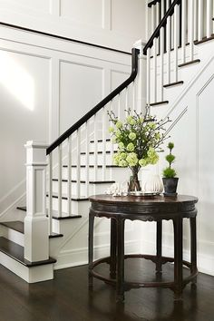 """Everyone of us is looking for """"the stairway""""….Chic foyer opens to a staircase fitted with white spindles and a black railing. Everyone of us is looking for """"the stairway""""….Chic foyer opens to a staircase fitted with white spindles and a black railing. White Staircase, Staircase Remodel, Staircase Makeover, Staircase Railings, Staircase Design, Banisters, Staircase Ideas, Stair Spindles, Staircase Walls"""