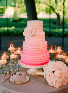 beautiful striped-moderately ruffled look pink ombre wedding cake - surrounded by a light pink peony bouquet and varied size cylinder vases with floating candles Cake Pink, Pink Ombre Cake, Coral Cake, Pretty Cakes, Beautiful Cakes, Amazing Cakes, Cupcake Torte, Wedding Trends, Wedding Ideas
