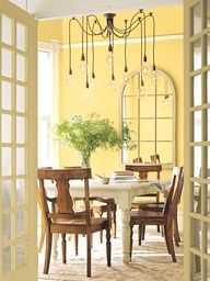Golden Honey from Benjamin Moore on the wall. Sunny yet class, the slight gray undertone makes it among the best yellow paint colors for virtually any room. Accent colors include decatur buff HC-38 and mascarpone AF-20. (This would look really nice in a kitchen or dining room)