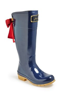 Adorable rain boots with cute bow on the back.
