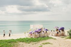 Beach Wedding with violet umbrellas, styles of elegance.