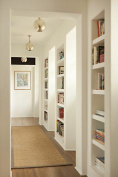 shelves along window hallway (love the lights too!)