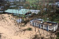 Dunk Island, smashed by Cyclone Yasi. The iconic pool is under the sand left. Brian Cassey / news.com.au