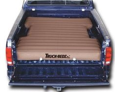 This bed in the back of a truck is a great inflatable air mattress solution when camping, backpacking, etc.