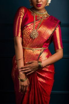 South Indian bride. Gold Indian bridal jewelry.Temple jewelry. Jhumkis. Red silk