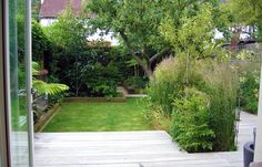 Lawn and decking in small North London garden
