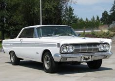 1964 Mercury Comet Caliente.  Ours was white like this one and the first car my Dad bought with an automatic transmission.  Finally had my license and was allowed to use this baby for dates. Highly sought after as a collector car now.