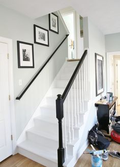 Painted Staircase Remodel - White Painted Stairs with Black Stained Railings