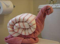 doblar toallas en forma de caracol