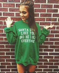 SANTA DON'T LIKE YOU AND HE LIKES EVERYONE FUNNY CHRISTMAS SWEATSHIRT.  Perfect for an ugly holiday sweater party, Secret Santa Gift, or just to wear during the Xmas Season!