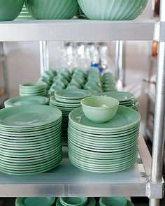 Martha's basement: and she has all of this spare space in her basement to stack her dish collections, house them until she uses them for parties, IF she ever uses them at all...not having a hubs or lil kids living in the house comes in handy when you want space for all of your shtuff, I 'spose.