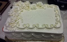 This proves a 1/4 sheet cake can be elegant. This is one of my more demure designs. My Client asked for a sheet cake that looked like a...