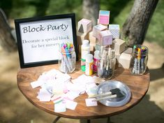 For a baby shower, have guests decorate a block for the baby to build with in the future.