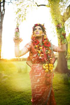 Gaye Holud Bride in Red  with Redand Yellow Floral Jewelry
