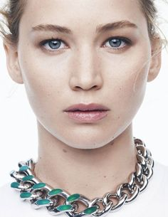 Jennifer Lawrence close-up with no-makeup look and chunky chain necklace // Photo c/o Dior