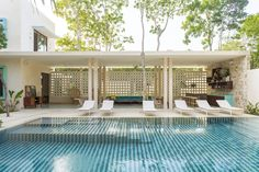 The tropical retro mid century Hotel Tiki Tiki Tulum. Signature stripes pool www.hoteltikitiki... Tile floors, lattice, Architecture and Interior Design by Arturo Zavala Haag