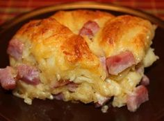 Cheesy Ham Biscuit Pull Aparts Recipe    1 (16.3 oz) Pillsbury Grands Flaky Layers Biscuits (I used the buttery flavor).  1 egg  2 tablespoons milk  3/4 cup diced ham  1/4 cup thinly sliced green onion  1/2 cup shredded cheddar  1/2 cup Monterey Jack cheese  1/2 teaspoon granulated garlic