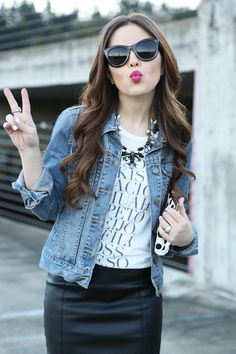 Edgy cool vibe: graphic tee, denim jacket, statement necklace, faux leather skirt, pumps. Lips: BareMinerals Marvelous Moxie: Risk it All.