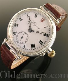 An early round silver vintage Longines watch, 1917
