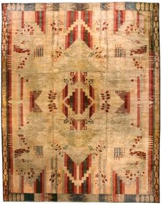 A French Art Deco carpet BB4580 - 'An exceptional early 20th century Art Deco modern carpet, the sand field with scattered red...