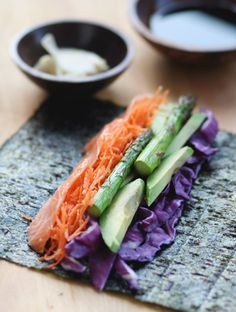 #paleo Salmon Veggie Rolls: 1 nori seaweed sheet; ¼ cup sushi grade salmon, sliced thin; ¼ avocado, sliced thin; ¼ cup purple cabbage, chopped; 1-2 roasted asparagus spears; 1 carrot, grated; SUBSTITUTE Coconut Aminos for tamari, for serving