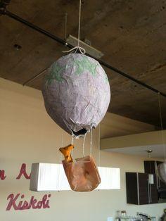 Papier mâché hot air balloons: start with a blown up ballon and pop after paper dries.