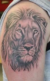 African Lion Face Tattoo on Bicep