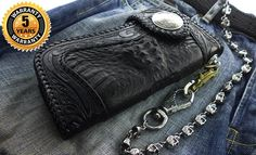 This is the crocodile and leather wallet called The Reaper. An amazing work of art. Caiman crocodile skin surrounded by hand tooled leather. As usual you get a full 5 year warranty with all of our wallets.