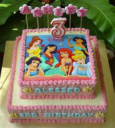 I love this gorgeous Disney Princess birthday cake.  It is a 2-tier cake decorated with a vibrant and fun edible cake topper.  The topper features all of the popular princesses.  Your little girl and her friends will love it!