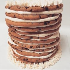 """While I love a good large cookie, this is my favorite way to make a """"cookie cake"""" - I made large chocolate chip cookies and layered them with  fluffy vanilla buttercream in between! #cookiecake #chocolatechipcookies"""