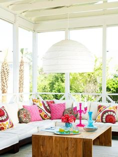 Screened-in porch with colorful accents